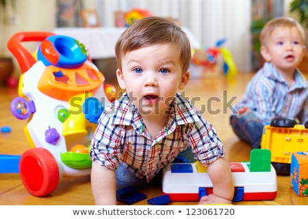 child toddler playing toys at home or kindergarten Stock photo © Lopolo