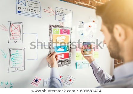 ui · designer · fejlesztő · kéz · tart · okostelefon - stock fotó © dolgachov