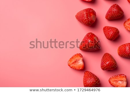 Flat lay composition with strawberries on a pink background.  Stock photo © Illia