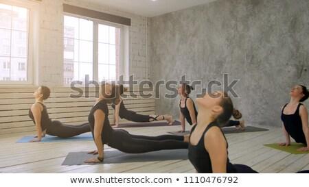 Aligning body with sun salutation exercise Stock photo © pressmaster