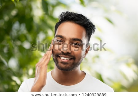 sonriendo · indio · hombre · tocar · barba · personas - foto stock © dolgachov