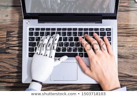 robô · trabalhando · laptop · robótico · mão · código · binário - foto stock © andreypopov