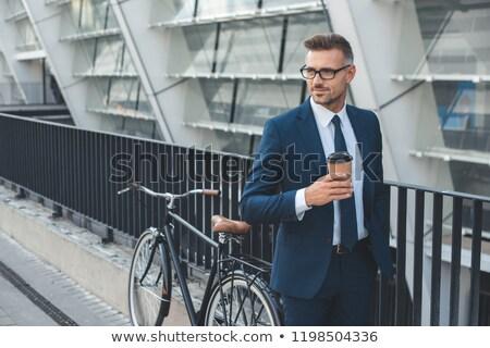 man in eyeglasses on city street Stock photo © dolgachov
