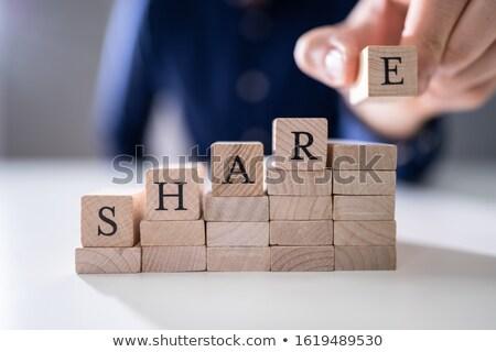 Man's Hand Placing Last Alphabet Of Word Share Stock photo © AndreyPopov