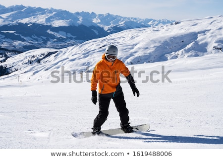 Male Snow Boarder Enjoying Riding Snow Board On Track Stock photo © AndreyPopov