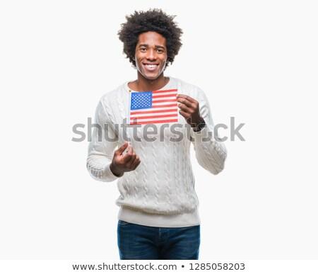 Mosolyog férfi zászló Egyesült Államok Amerika nap Stock fotó © dolgachov