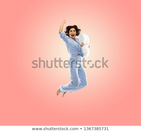 happy woman in blue pajama jumping high over pink Stock photo © dolgachov