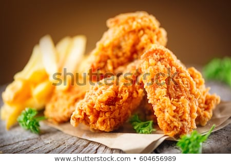 Fried chicken drumstick and french fries Stock photo © grafvision