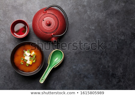 Japanese tea, soup spoons and chopsticks Stock photo © karandaev