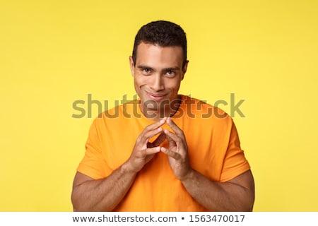 Sinsi genç gizli kötü plan parmaklar Stok fotoğraf © benzoix