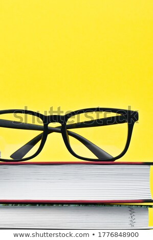 Glasses and group of old dirty books Stock photo © boroda