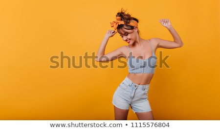 young beauty woman dances in shorts stock photo © paha_l