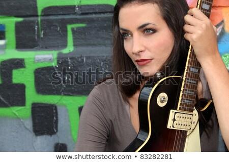 Capelli scuri donna chitarra misterioso foresta Foto d'archivio © photography33