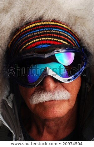Older man on a mountain with skis Stock photo © photography33
