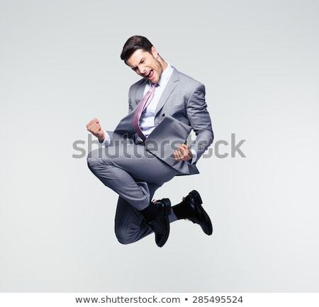 boldog · üzletember · ugrik · levegő · szürke · üzlet - stock fotó © photography33