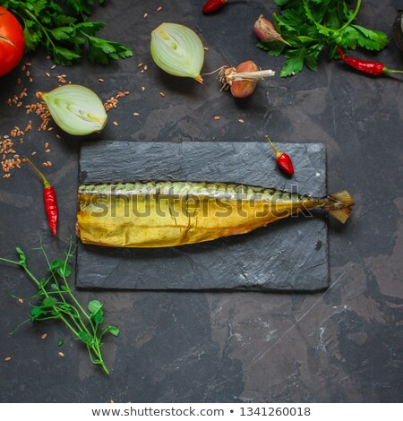 dish with the cut smoked mackerel on wooden plate stock photo © ozaiachin