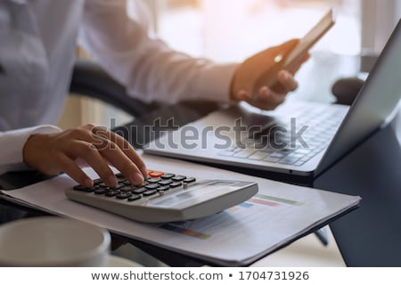 Woman using a calculator at work Stock photo © photography33