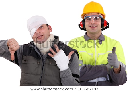 Healthy construction worker standing next to an injured man Stock photo © photography33