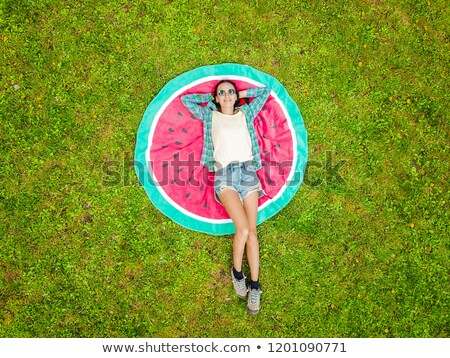 Woman lies on her back in grass. Stock photo © borysshevchuk
