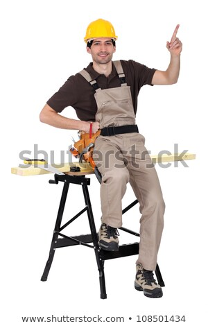 a carpenter pointing up and showing something stock photo © photography33