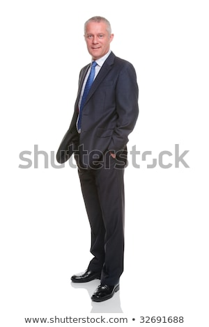 Businessman stood with his hands in his pockets Stock photo © photography33