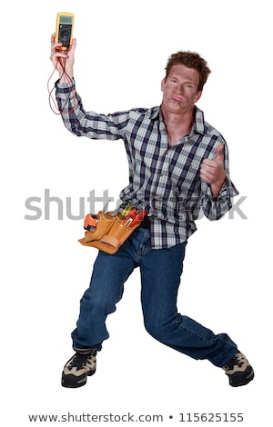 An electrocuted man holding a multitester Stock photo © photography33