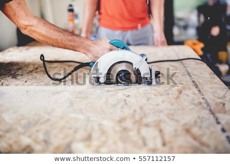 apprentice with circular saw stock photo © photography33