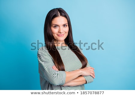 Gorgeous charming female turning and looking at camera stock photo © stockyimages