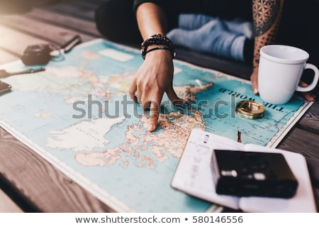 Stock photo: Young woman with a map