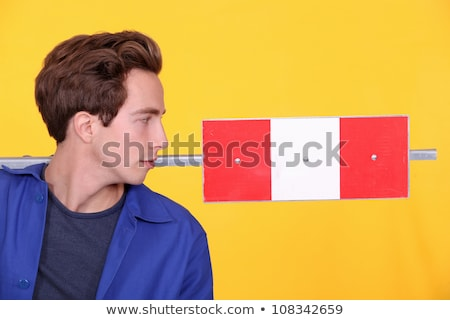 Man stood with road sign in studio Stock photo © photography33