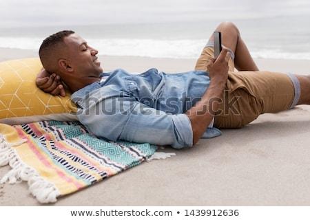Mosolyog fiú tengerpart homok anya nő Stock fotó © ElinaManninen