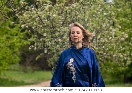 Mosolygó nő kimonó orchidea divat szépség női Stock fotó © wavebreak_media