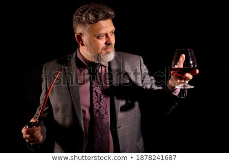 Portrait of thoughtful business man with glass wine stock photo © Discovod