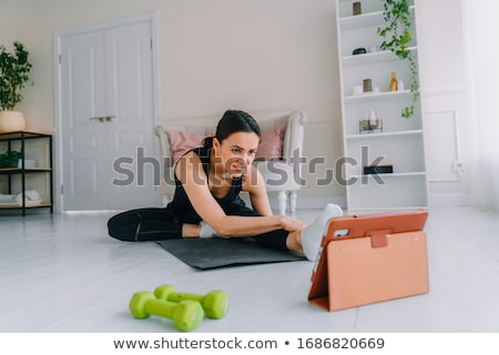 Healthy woman with dumbbells working out Stock photo © stepstock