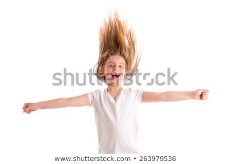 blond kid girl indented jumping high wind on hair Stock photo © lunamarina