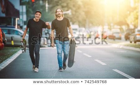 Skateboarder Riding Skateboard at City Street Pavement Stock photo © stevanovicigor