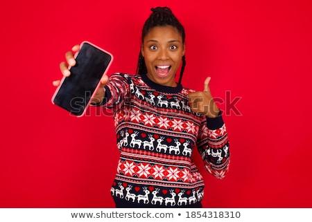 african woman showing smartphone stock photo © hasloo