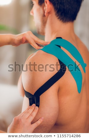 physiotherapist with tapes Stock photo © Flareimage