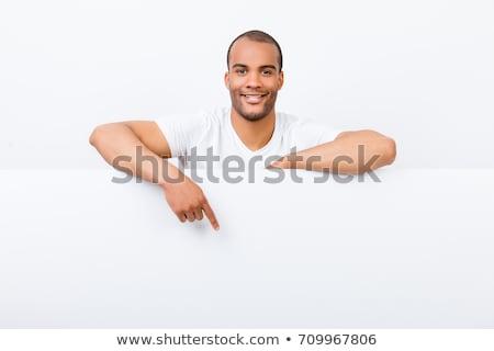 business man pointing down stock photo © fuzzbones0