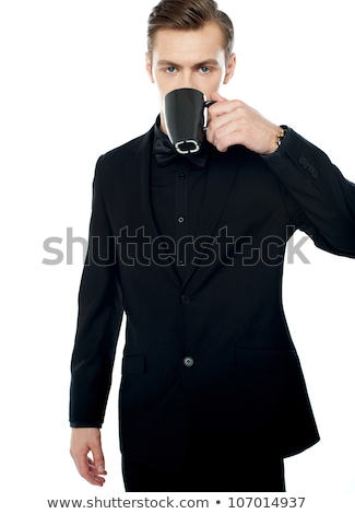 Man drinking from mug and looking over Stock photo © ozgur