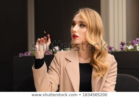 Pretty blonde girl thinking about something in cafe Stock photo © deandrobot