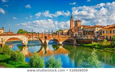 Ponte Pietra on river Adige Stock photo © OleksandrO