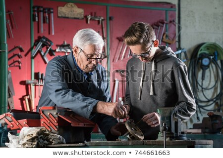 Happy young man tinkering stock photo © nyul