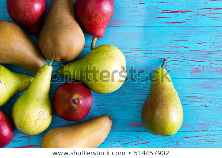Stained blue and crackled surface with pears Stock photo © ozgur