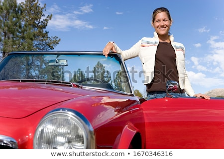 Women leaning out of convertible car Stock photo © IS2