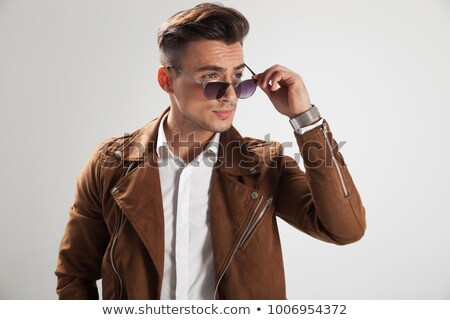side view of a fashion man taking off his sunglasses  Stock photo © feedough