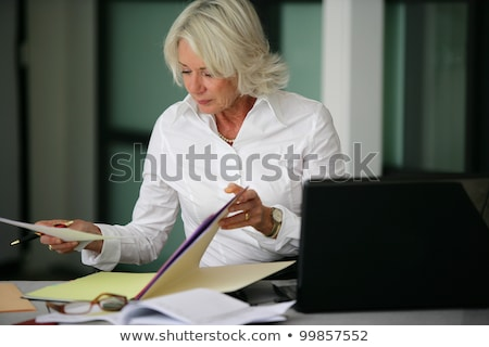 Woman looking through files Stock photo © IS2