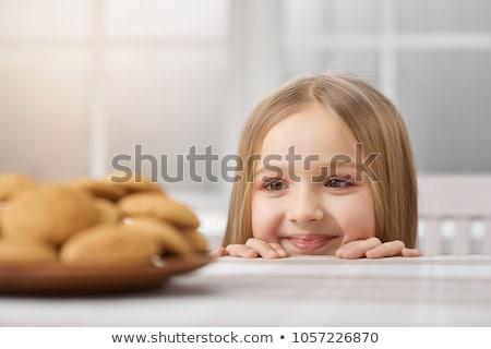 cute happy little girl in white shirt with milk stock photo © Traimak