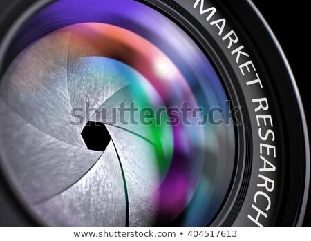 marketing research on front glass of camera lens closeup stock photo © tashatuvango