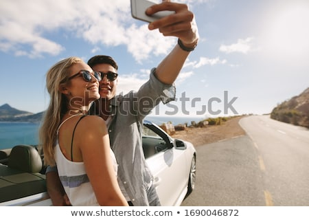 Young man wearing sunglasses driving convertible car Stock photo © IS2